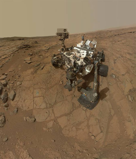 "This self-portrait of NASA's Mars rover Curiosity combines dozens of exposures taken by the rover's Mars Hand Lens Imager on Feb. 3, 2013 plus three exposures taken May 10, 2013 to show two holes (in lower left quadrant) where Curiosity used its drill on the rock target ""John Klein"" (Photo: NASA/JPL-Caltech/MSSS)"