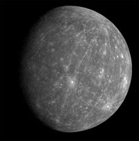 Mercury's dark surface a result of comet dust