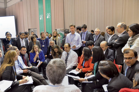 Negotiators huddle to resolve issues over differentiation between developed and developing countries