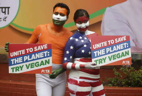 PETA activists in Delhi call on Indian and US leaders to try vegan to combat climate change (Photo by Vikas Choudhary)