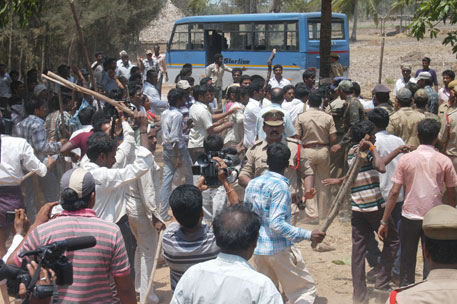 Farmers clashed with the police after they obstructed officials from entering the venue of the public hearing