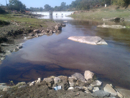 Poisoned Nalkari river flows from the Patratu Thermal Power Station in Jharkand
