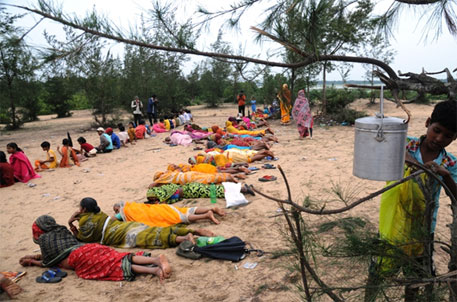A file photo from 2011 shows women and children holding ground in Gobindapur village preventing government officers from acquiring land (photo: Sayantan Bera)
