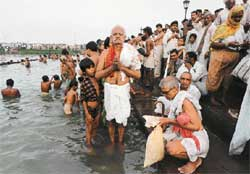 Hindu devotees washing away th