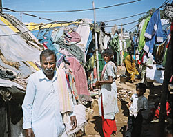 Land titles to urban slum dwellers in Bangalore