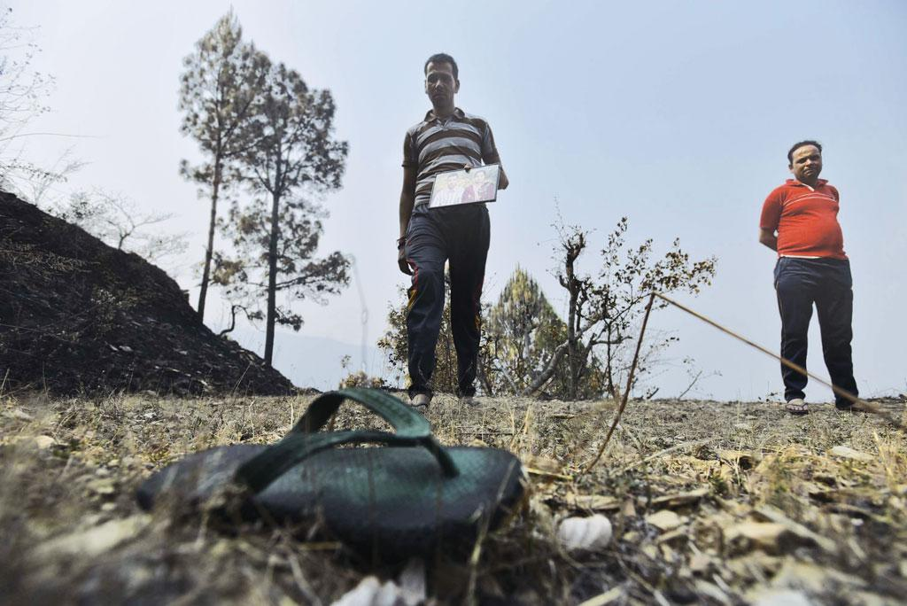 On April 27, Digamber lost his wife to a forest fire in his village in Pauri Garhwal district of Uttarakhand. The charred slipper and a photograph are the only memories of his wife now (Photographs: Vikas Choudhary)