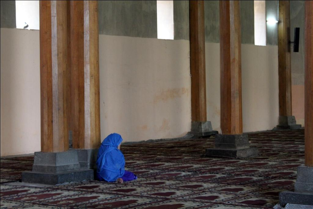 A Kashmiri woman prays inside the historic Jamia Masjid in Srinagar. According to the survey, women in the Valley are more afflicted by mental distress than men    Credit: Flickr