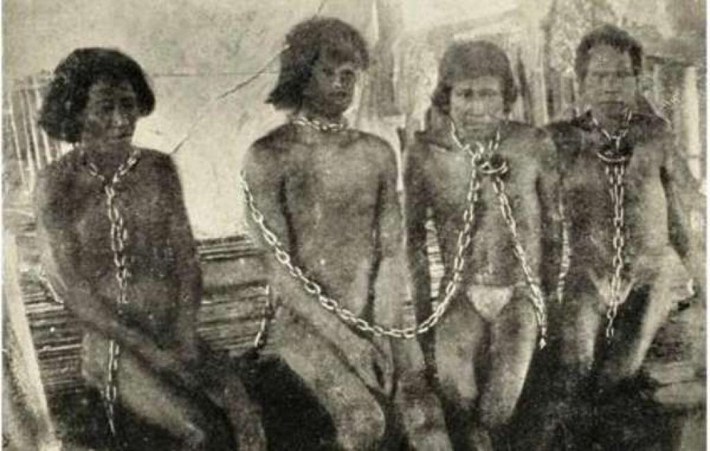A photo of enslaved Amazon Indians during the rubber boom of the early 1900's from the book, The Putumayo: The Devil's Paradise (Photo credit: Walter Hardenberg, via Wikimedia Commons)