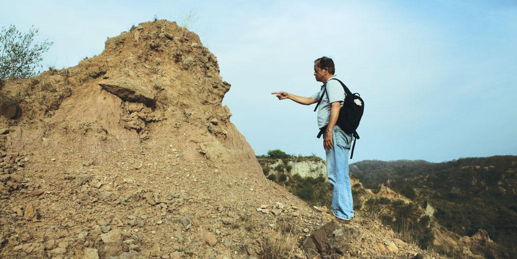 Mukesh Singh, who co-led the research team, shows a site where he found stone tools near Masol. Till a few decades ago the Siwalik Hills were the focus of attention for signs of early humans