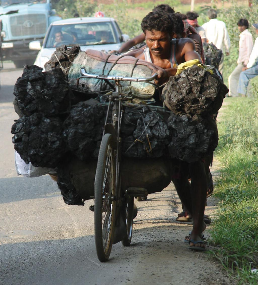A man carries coal from coalmining