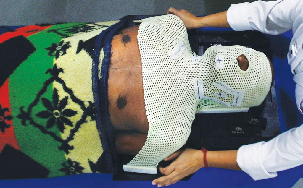 A cancer patient gets ready for radiotherapy at the North Bengal Oncology Center near Siliguri (Photo: Reuters)