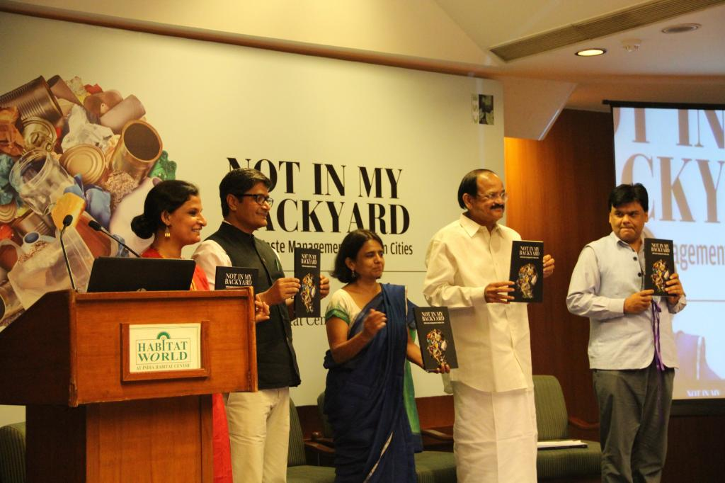 Union Minister for Urban Development, Housing & Urban Poverty Alleviation releasing the book 'Not In My Backyard'