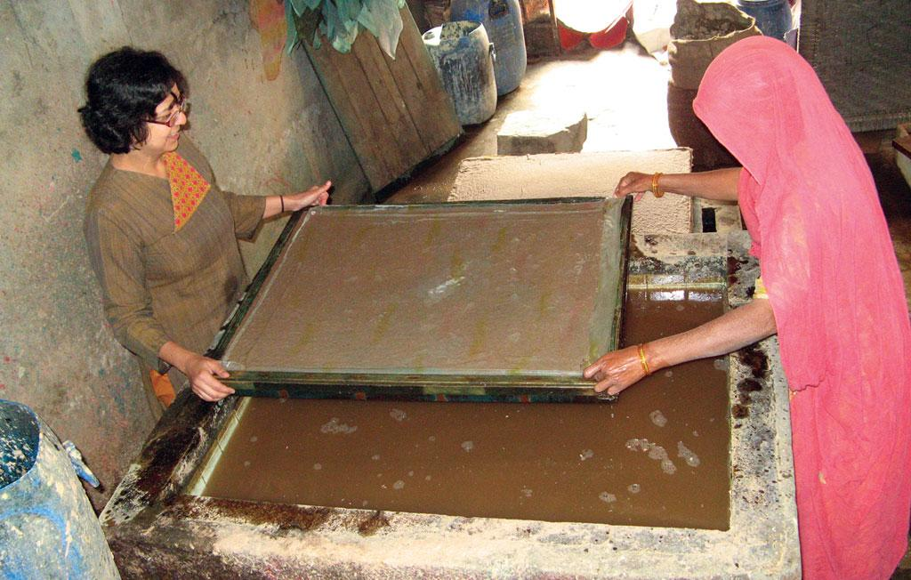 Mahima Mehra, owner of Haathi Chaap paper, makes a wet sheet from elephant dung slurry at the manufacturing unit in Jaipur. The sheet is then sun-dried (Courtesy: Haathi Chaap Paper)