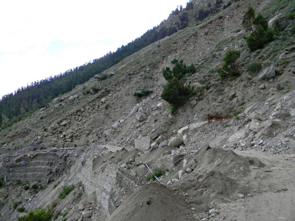 Land slide activated by road built by Himachal Pradesh Power Corporation for Kashang project's dam site at Pangi village. This siled let to severe damges to orchards & houses at ward 5 of Pangi.