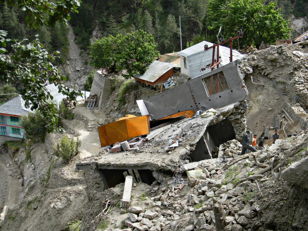 Reminents of houses surrounded by debris of land slide in Pangi village.