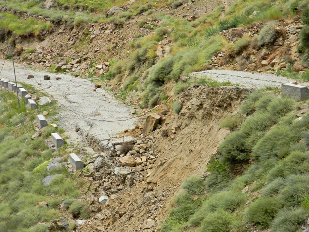 Road to Sudarang Village slides down.