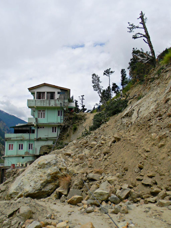 Deva Devi's house damged by land slide in Sudarang Village.