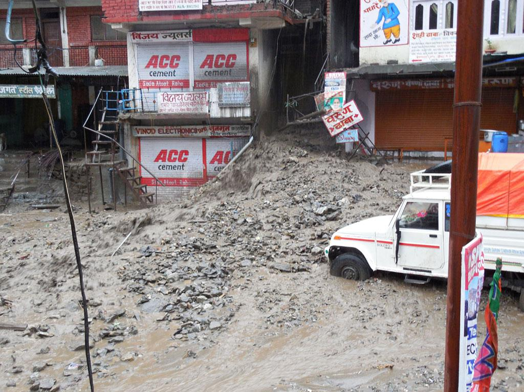 Land slide above Tapri village brought down muck into the shops in the market.Tapri is located on the right bank of the Satluj river & the tunnel of Jaypee's 1200MW Karcham Wangtoo project passes through it.