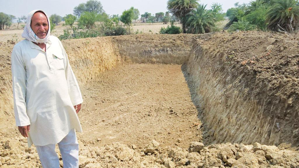 Rudra Pratap Mishra of Ganj village in Mahoba district, Uttar Pradesh, got a pond dug on his farmland, but is unsure about the durability of the structure (Photo: Kundan Pandey)