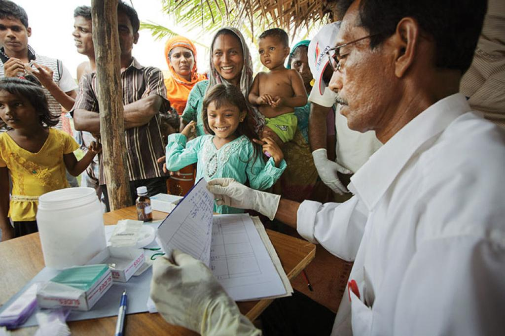 A public health officer treats patients at a