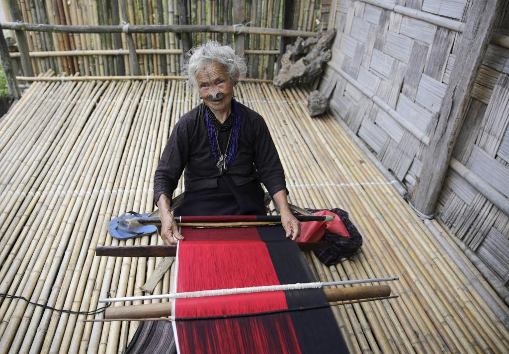 A woman weaves a traditional skirt called gale at her house.Credit: Vikas Choudhary