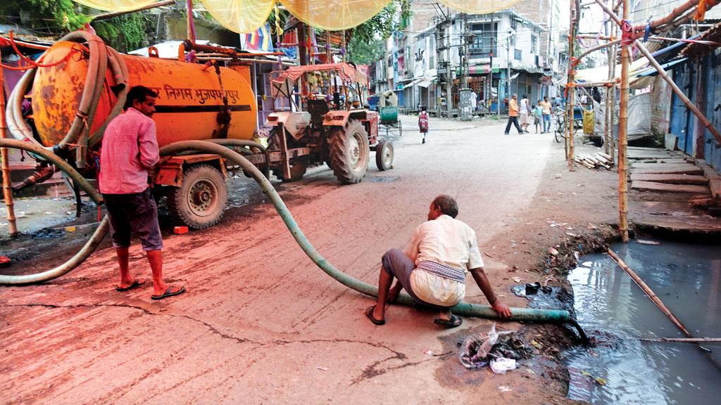 In Bihar's Muzaffarpur city most households have toilets with septic tanks. The municipal corporation collects faecal sludge and releases it in open drains (Photo: Bhitush Luthra)