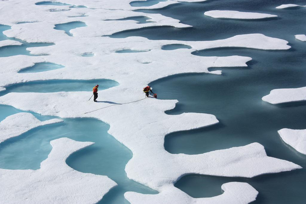 These record low sea ice levels have been associated with exceptionally high temperatures for the Arctic region. Credit: NASA / Flicker