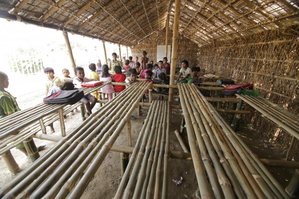 Children attend a makeshift school made with bamboo. Credit: Vikas Choudhary