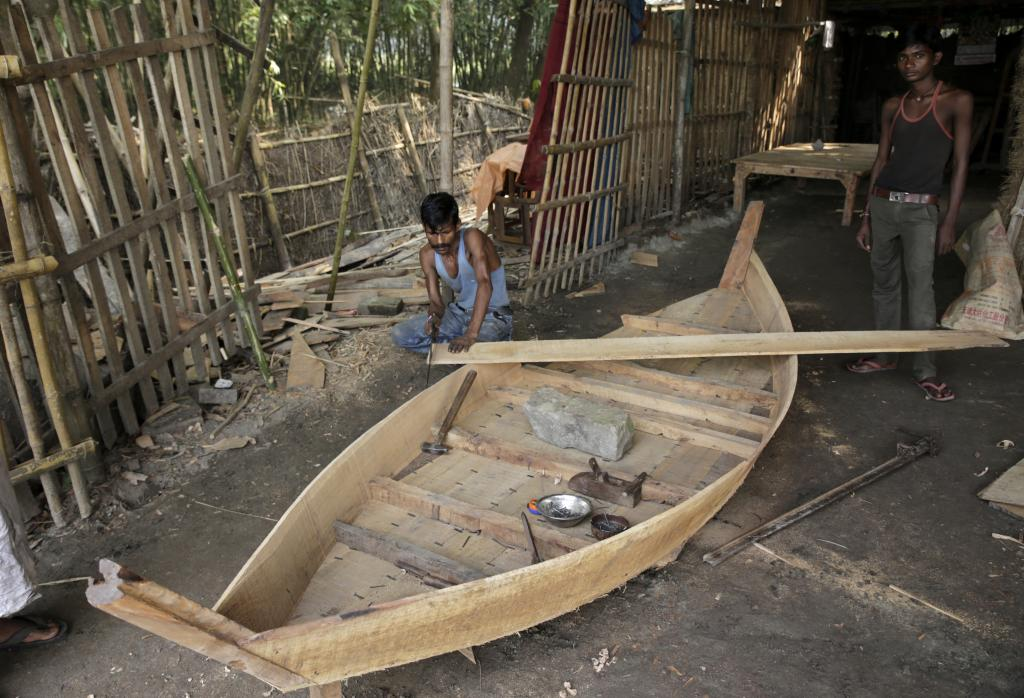 Boats are an integral part of people's lives in the Kosi region. Jamun wood is prized for making boats but is no more abundantly available. Instead jungle jalebi that grows in the wild is more commonly used.  Credit: Vikas Choudhary