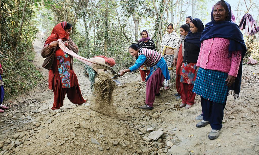 Mahila mandal members in Bhayarta gram panchayat in Mandi district construct a stormwater drain in their village