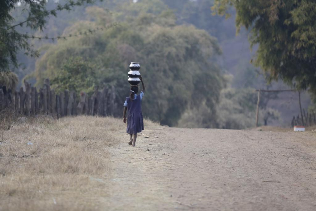 Girls in rural India drop out of school to help family members carry the burden of fetching water. Girls as young as ten contribute to this task