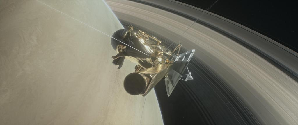 This illustration shows NASA's Cassini spacecraft about to make one of its dives between Saturn and its innermost rings as part of the mission's Grand Finale