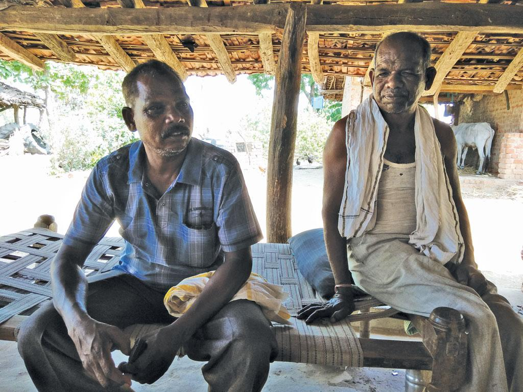 Pandu Singh Marshkole (seated on the right), a Gond tribal of Betul's Dolhara village, says about 200 families in the village want pattas for the land they have lived on for decades.  (Photos: Jitendra)