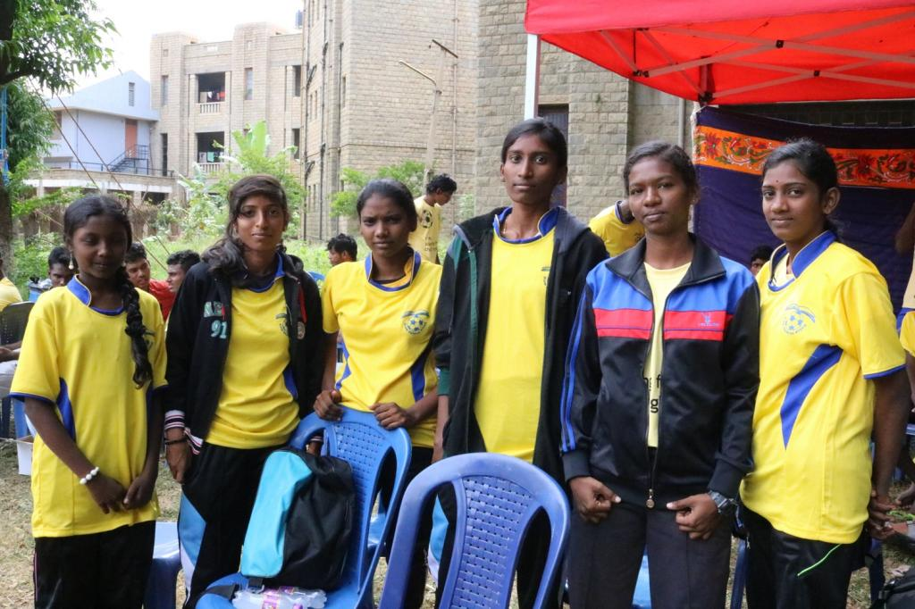 Marthal (second from right) coaches football to children from her slum