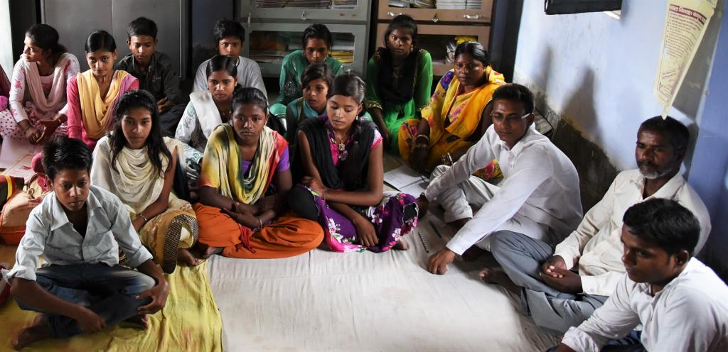 Sanjeev (third from the Right) in a meeting with the community. Credit: CRY