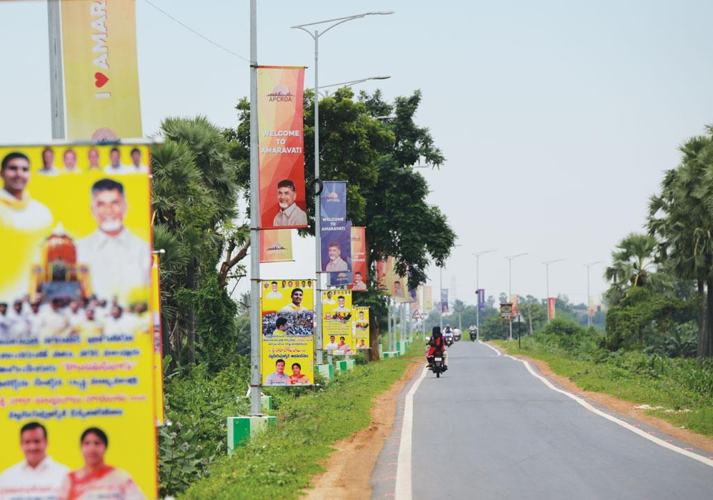 The road to the proposed Andhra Pradesh capital of Amaravati is lined with posters that claim it is a city of hope. But displaced farmers tell a different story (Photo: Vikas Choudhary)