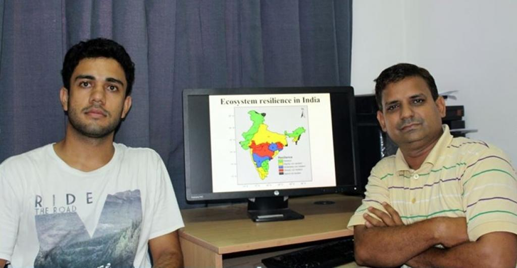 Dr Manish Goyal (Right) and Ashutosh Sharma with ecosystem resilience map they have developed. Credit: India Science Wire