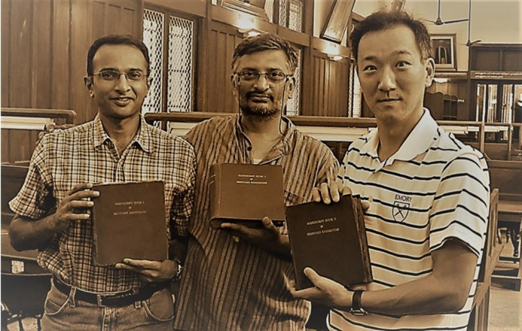 Professor Ono (extreme right) with the original notebooks of Ramanujan. Credit: India Science Wire