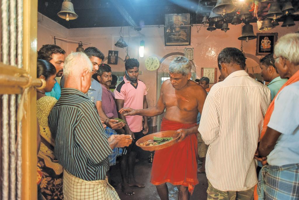 Devotees partake of prasad at Bobburulingeshwara shrine. The temple is situated on an island in the middle of the critical Aghanashini estuary where the Tadadi port is being planned