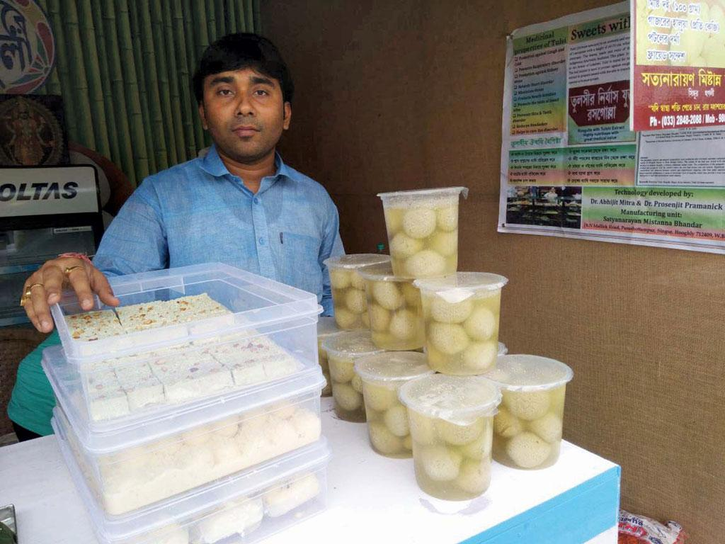 Abhishek Roy at his sweet shop in West Bengal's Singur town with tulsi rosogollas on display. His sales have tripled since the Roy brothers launched the healthy variant (Photo: Dhrubonath Das)