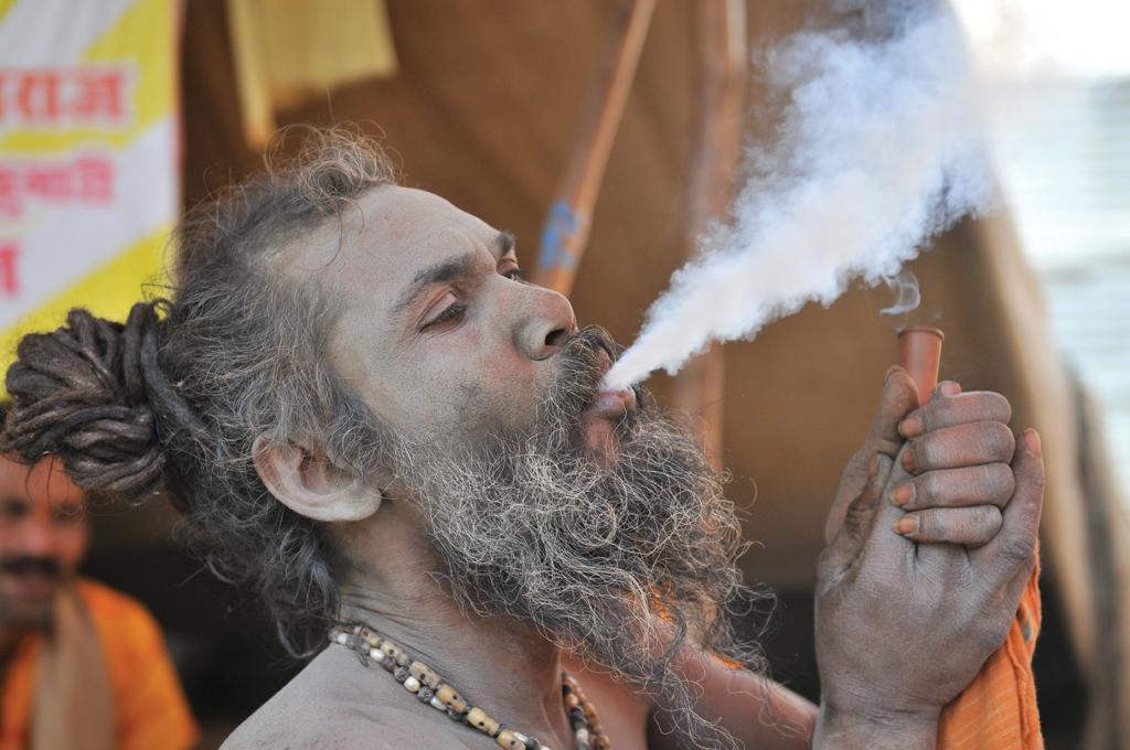 A sadhu  smoking marijuana in the Kumbh  Mela in Allahabad  (Photo: Meeta Ahlawat)