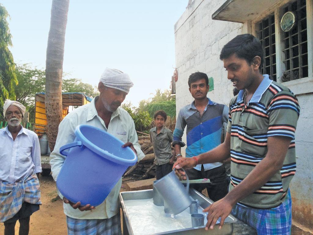 Farmers at a milk procurement centre of the Karnataka Milk Federation. The cooperative procures milk from  80 per cent of the farmers in the state (Courtesy: grain.org)