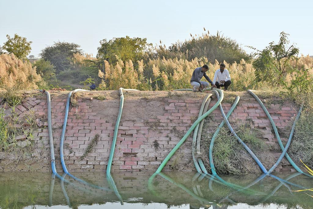 Farmers at Kumbharia village in Morbi siphon canal water and store in low-lying areas to ensure last rounds of irrigation to their rabi crops (Photos: jitendra)