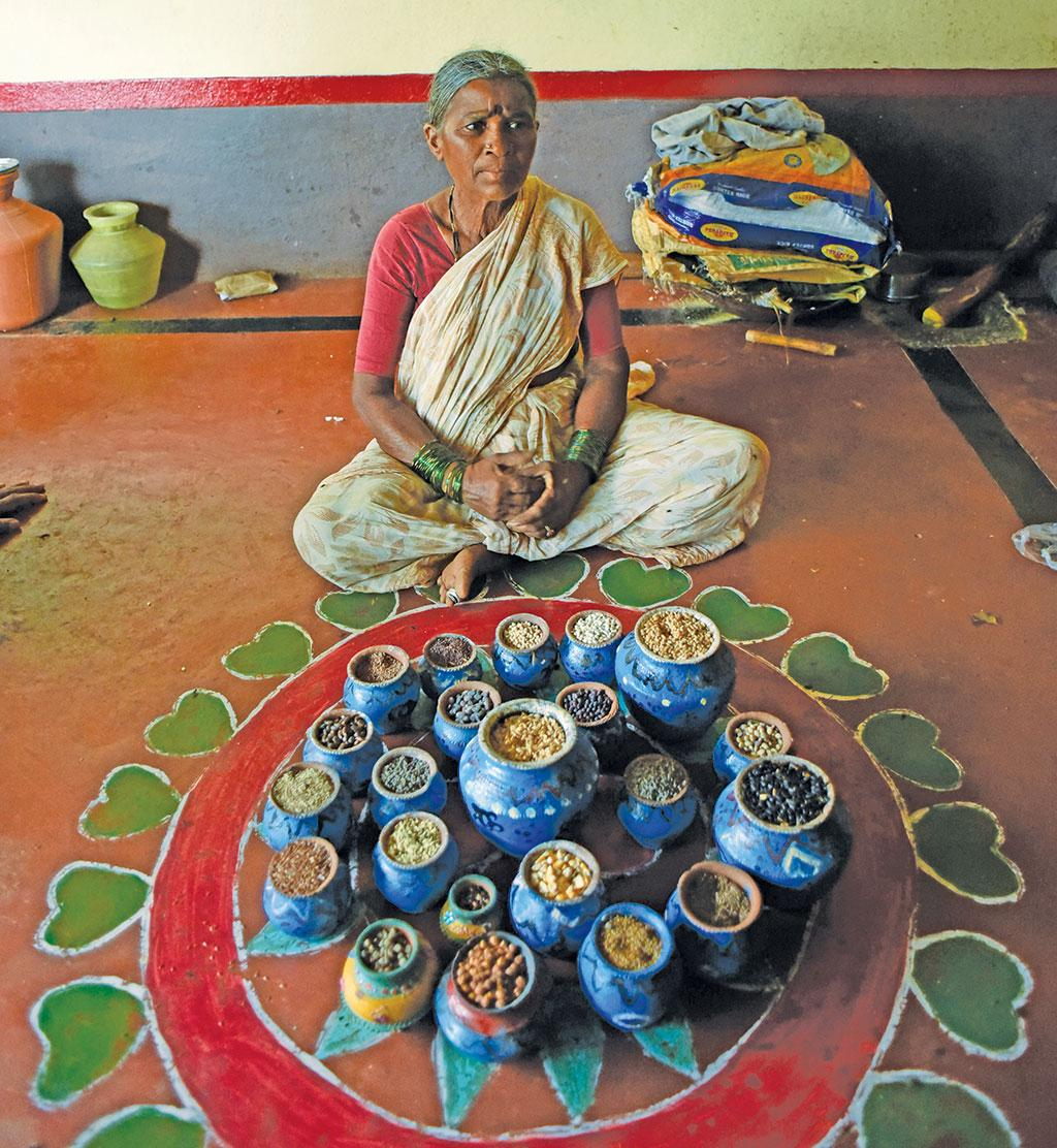 Paramma, a traditional seed saver of Telangana, showcases different types of indigenous seeds kept at her house (Photo: Adithyan)