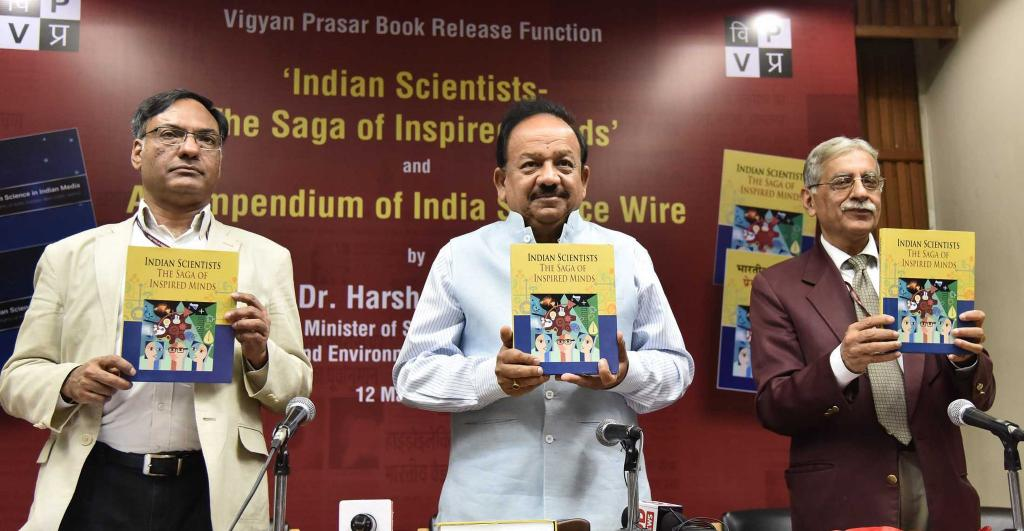Prof. Ashutosh Sharma, Dr. Harshvardhan and Shri Chandermohan releasing the book. Credit: PIB