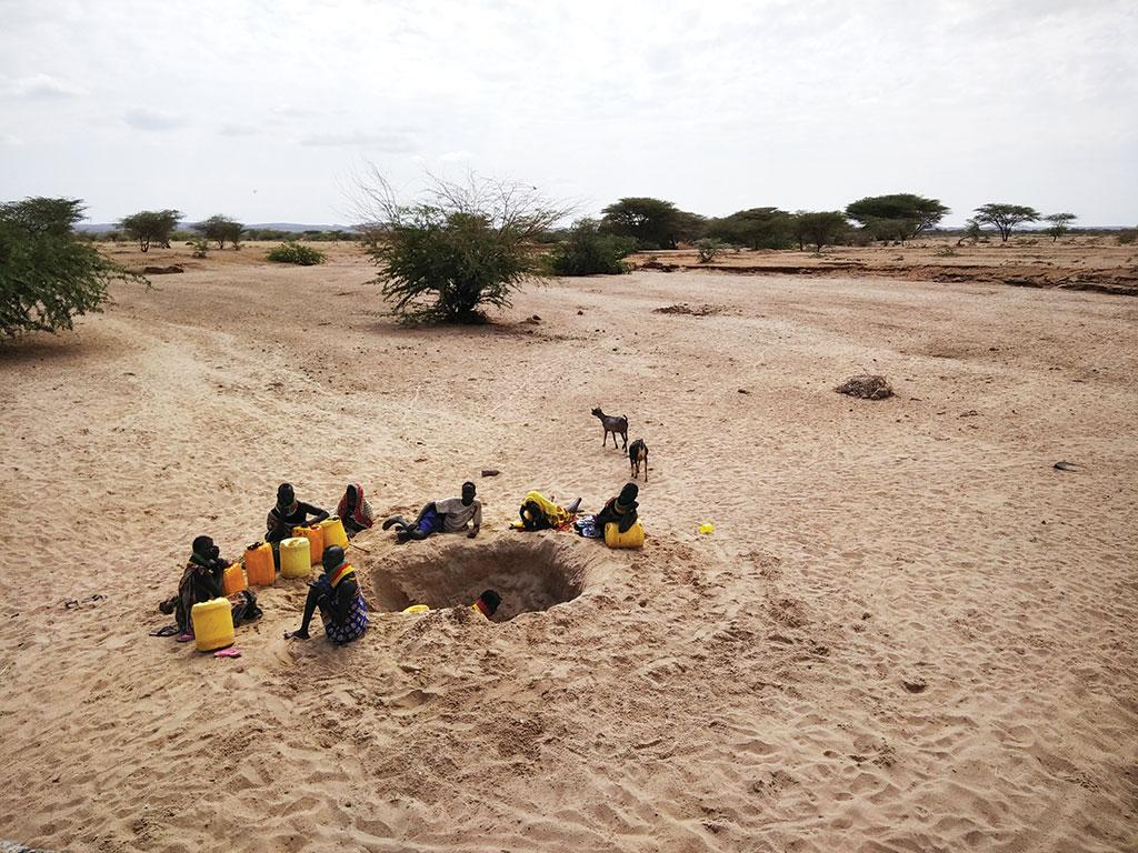 A group of young girls dig up a dried riverbed to get water in Turkana county in northern Kenya (Photo: Jitendra)