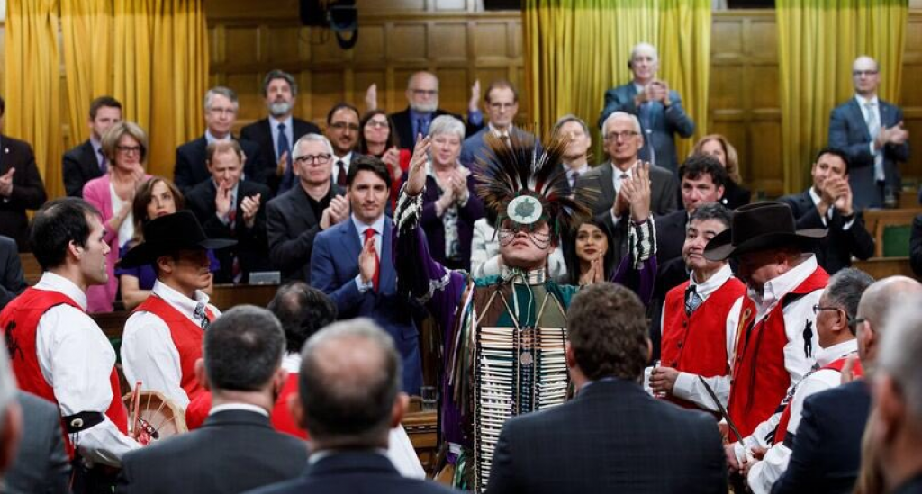 A member of the Tsilhqot'in Nation performs a traditional ceremony on the floor of the Canadian House of Commons as Prime Minister Justin Trudeau and other lawmakers look on    Credit:Justin Trudeau/Twitter