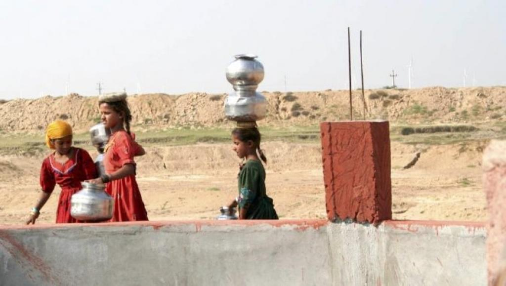 Young girls at a well in Gujarat, which is already facing a water scarcity. Credit: Mark Charmer/The Third Pole