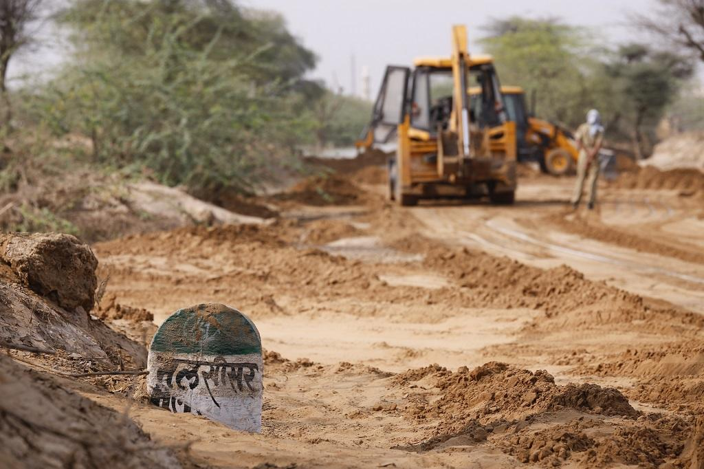 JCB machines remove the silt left after the Rs 588-crore dam, constructed under the Kumbharambh Arya Lift Project, inundated the entire village