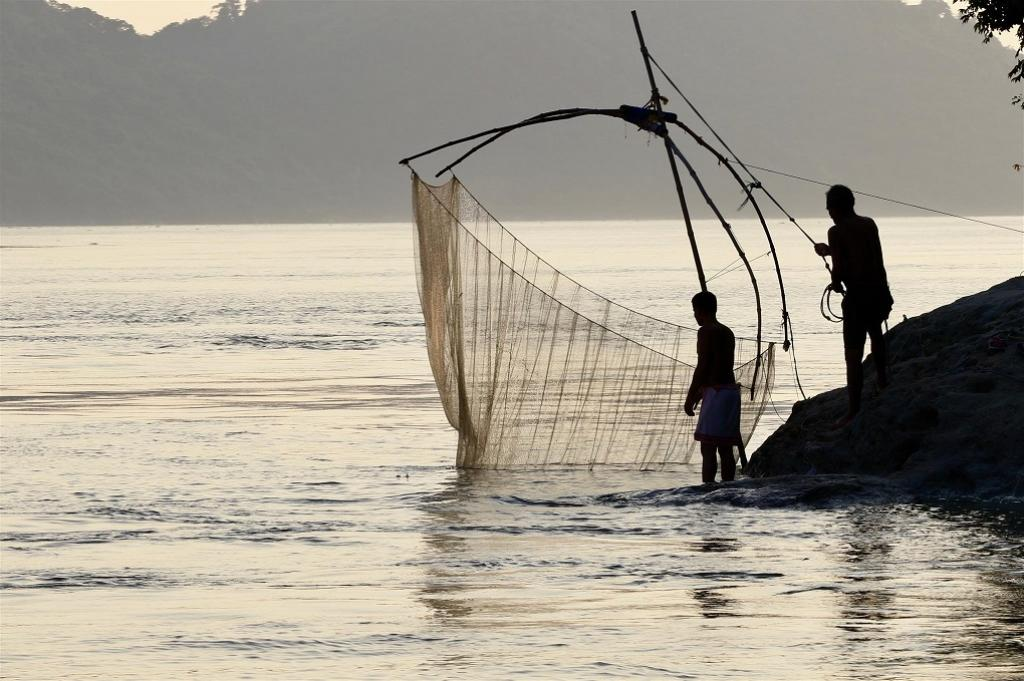 Fishermen on the Brahmaputra, a river that winds through four countries. Credit: Sumit Vij